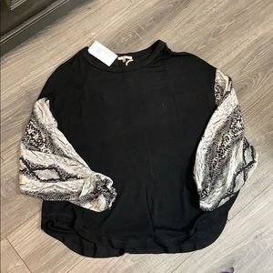Shirt black with snake skin print sleeves. Small